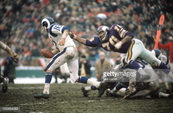 Vikings Jim Marshall chasing the Rams Roman Gabriel